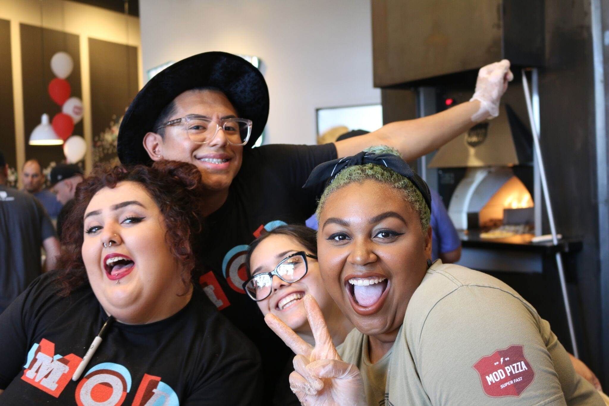 MOD Pizza employees smiling during a Talent Rewire event